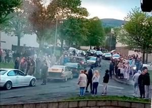STUNTS: Large crowds congregate n Poleglass as cars do doughnuts as a mark of respect to Bo Monaghan