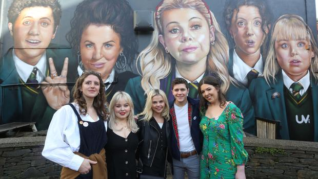 Derry Girls cast members Louisa Harland, Nicola Coughlan, Saoirse-Monica Jackson, Dylan Llewellyn, and creator Lisa McGee