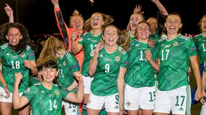 'WE'RE GOING TO THE EUROS'... A jubilant NI Women's team at Seaview