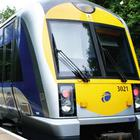 Police searched passengers as they got off a train in Belfast.