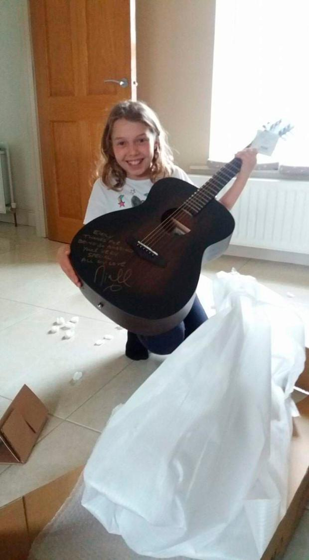 Emily Magee with guitar from Niall Horan