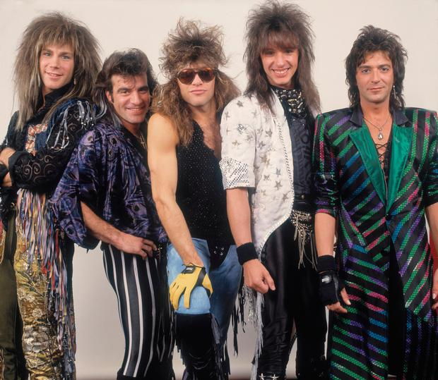 Portrait of American rock band Bon Jovi backstage before a performance, Illinois, early March, 1987. Pictured are, from left, David Bryan, Tico Torres, Jon Bon Jovi, Richie Sambora, and Alec John Such. (Photo by Paul Natkin/Getty Images)