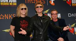 Bon Jovi members David Bryan (L) Jon Bon Jovi (C) and Tico Torres (Photo by Michael Dodge/Getty Images)