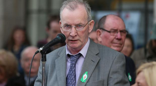 John Joe McCusker addresses members of Republican Sinn Fein outside the GPO on O'Connell Street in Dublin, during a ceremony to mark the centenary of the 1916 Easter Rising.