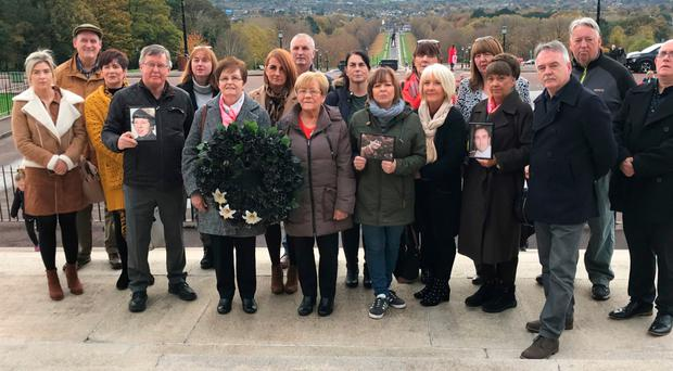 Families of the 16 people killed and secretly buried by republicans during the Troubles take part in the 13th annual All Souls Silent Walk at Stormont
