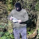 John Connolly has been named as the hooded man who read threats out to QIH directors.