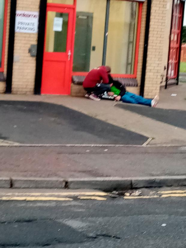 Drug addicts lie out the front of the Welcome Centre