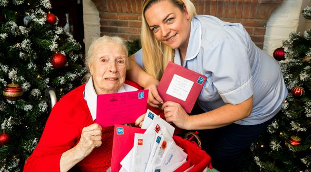 Kelly Brown, Activities Therapist at Ailsa Lodge Care Home in Bangor, with resident Ellen Stewart 89. Credit: Liam McBurney/RAZORPIX)