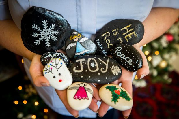 Stones painted as Christmas decorations delivered by a member of the public to residents. Credit: Liam McBurney/RAZORPIX