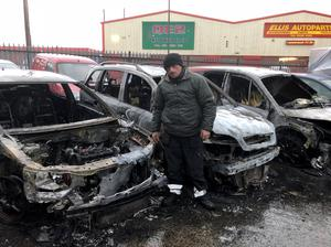 Joe Dunlop at his garage after a second arson attack in Carrickfergus