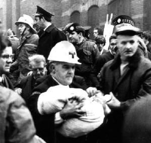 Horror: An ambulanceman carries the body of 17-month-old Colin Nicholl from the scene of a no-warning IRA explosion at a furniture showroom on the Shankill Road in 1971