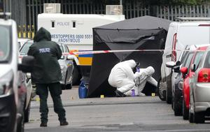 PSNI and forensic officers at the scene where Crossan was killed