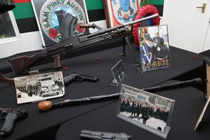 Guns and memorabilia of the UVF and Red Hand Commandos which were part of the exhibition of Loyalist artefacts during the history of the Northern Ireland conflict held in the Raven Social Club in East Belfast