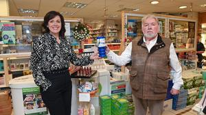 HERCULEAN EFFORT: Don McBurney, with pharmacy owner Zita Graham, has spent a lifetime helping others through his charity