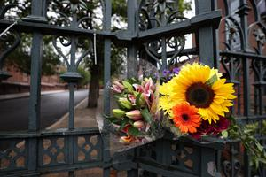Flowers left on the gates of St. Malachy's College, Belfast where Noah Donohoe attended school. (Liam McBurney/RAZORPIX)