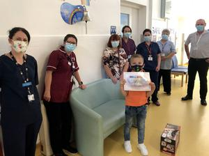Adam Watson pictured with staff the children's hospital in Belfast after his cancer treatment had finished. Mandatory Credit  / Stephen Hamilton