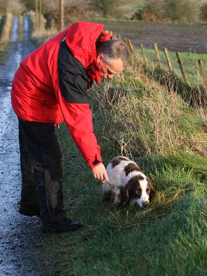 Dog handler Martin Grime, with 'Eddie', the Springer Spaniel dog. Picture. Maurice Thompson. 12-12-06