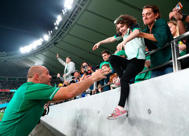 CHOFU, JAPAN - OCTOBER 19: Rory Best of Ireland reaches out to grab his children from the crowd following defeat in the Rugby World Cup 2019 Quarter Final match between New Zealand and Ireland at the Tokyo Stadium on October 19, 2019 in Chofu, Tokyo, Japan. (Photo by Stu Forster/Getty Images)