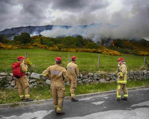 NI Fire and Rescue Service at the Scene of a large gorse fire on a steep hillside at Dollys Brae Car Park, Leitrim Road Castlewellan at the back  of Castlewellan Forest Park County Down on Friday Evening. Photo Paul Byrne