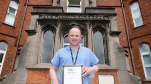 Dr Martin Duffy Consultant Anaesthia ICU with his Spirit of Northern Ireland COVID heroes award. Picture: Colm O'Reilly