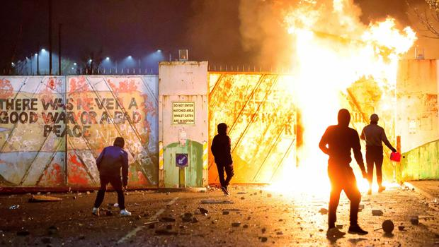 BEDLAM: Loyalists and republicans clash either side of the peace wall at Lanark Way in west Belfast