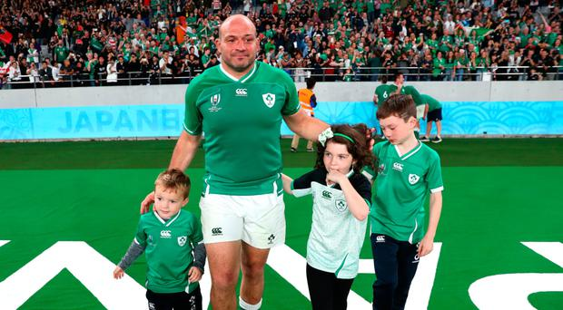 Rory Best of Ireland walks on the pitch with his children following defeat in the Rugby World Cup 2019 Quarter Final match between New Zealand and Ireland at the Tokyo Stadium (Photo by Stu Forster/Getty Images)