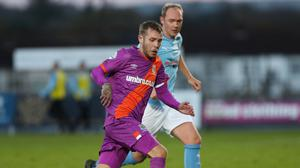 Linfield ace Kirk Millar chases down the ball