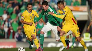 Northern Ireland striker Kyle Lafferty in action the last time they faced off against Romania