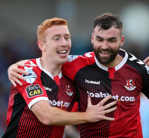 Crusaders' Jarlath O'Rourke (left) is congratulated on his winning goal against Crusaders by Johnny McMurray