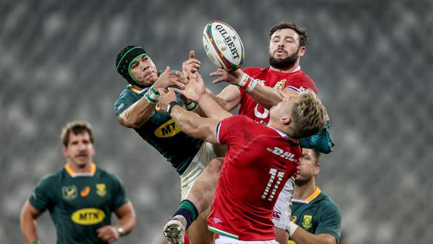South Africa's Cheslin Kolbe competes in the air with British & Irish Lions' Robbie Henshaw.
