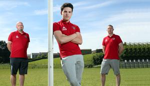 Kilrea United's Pierce Worrall-Hill (centre), who had been the subject of a 10,000 Swiss francs fine decision from FIFA, photographed at the club's pitch in Co Derry with club chairman Davey Sheils and secretary Shane Coyle