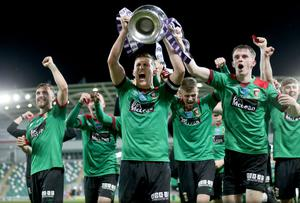 Glentoran captain Marcus Kane lifts the Irish Cup trophy with his team-mates