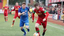 Cliftonville's Thomas Maguire gets away from Jake Richardson