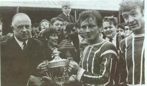Johnny McCurdy receives the 1965 Ulster Cup