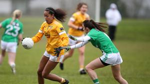 Antrim's Lara Dahunsi is challenged by Fermanagh's Courtney Miurphy.