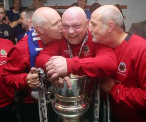 Alfie Wylie (right) celebrates another Irish Cup win with then Linfield boss David Jeffrey