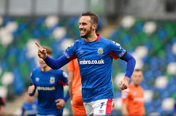 Linfield striker Andy Waterworth celebrates an opening day hat-trick