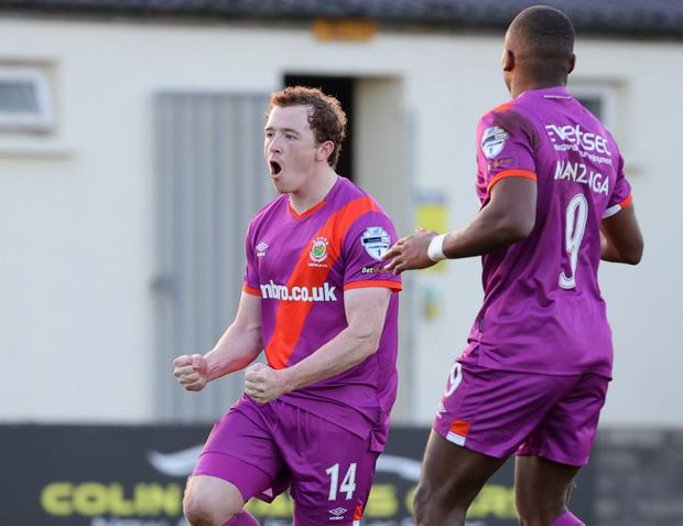 Shayne Lavery celebrates scoring for Linfield at Stangmore Park.