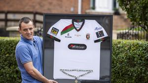 Former Glentoran defender Jason Hill pictured with his 2013 framed Irish Cup Final shirt at his home in Glengormley