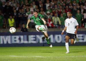 The iconic photo of Healy's crowning moment as a Northern Ireland hero; that winning goal against England.