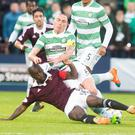 Seeing red: Hearts' Morgaro Gomis tackle on Celtic's Scott Brown which led to his sending off