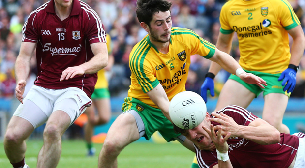 In the mix: Donegal's Ryan McHugh gains possession from Galway's Damien Comer at Croke Park