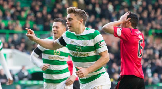 Early goal: James Forrest celebrates securing Celtic's early breakthrough against Brechin