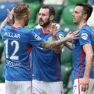 Final say: Kurtis Byrne is hailed after hitting Linfield's second