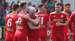Ryan Catney celebrates with Ryan Curran following Cliftonville's second goal on a day that left Crusaders boss Stephen Baxter counting the cost of injuries