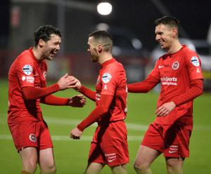 Larne celebrate on their way to their 3-0 win over Dungannon Swifts