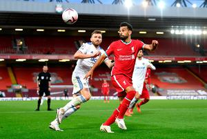 Stuart Dallas tracks down Liverpool ace Mo Salah in their clash at Anfield on Saturday