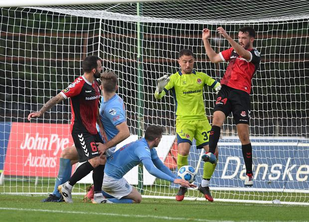 Josh Robinson in action for Crusaders against Ballymena United