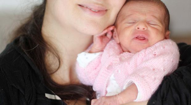 Three-week-old Nicole Riona Ghafari, who was born after a plane en route from Paris to Detroit landed at Belfast, with her mum Nicole