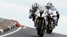Michael and William Dunlop battle for the lead on the final lap during todays Vauxhall International North West 200 Superbike race.